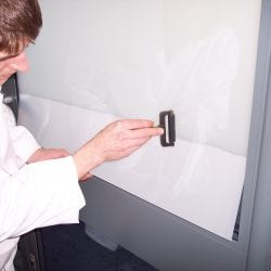 Switchable smart film installation on glass door