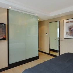 Smart glass shower cubicle in a luxury bedroom