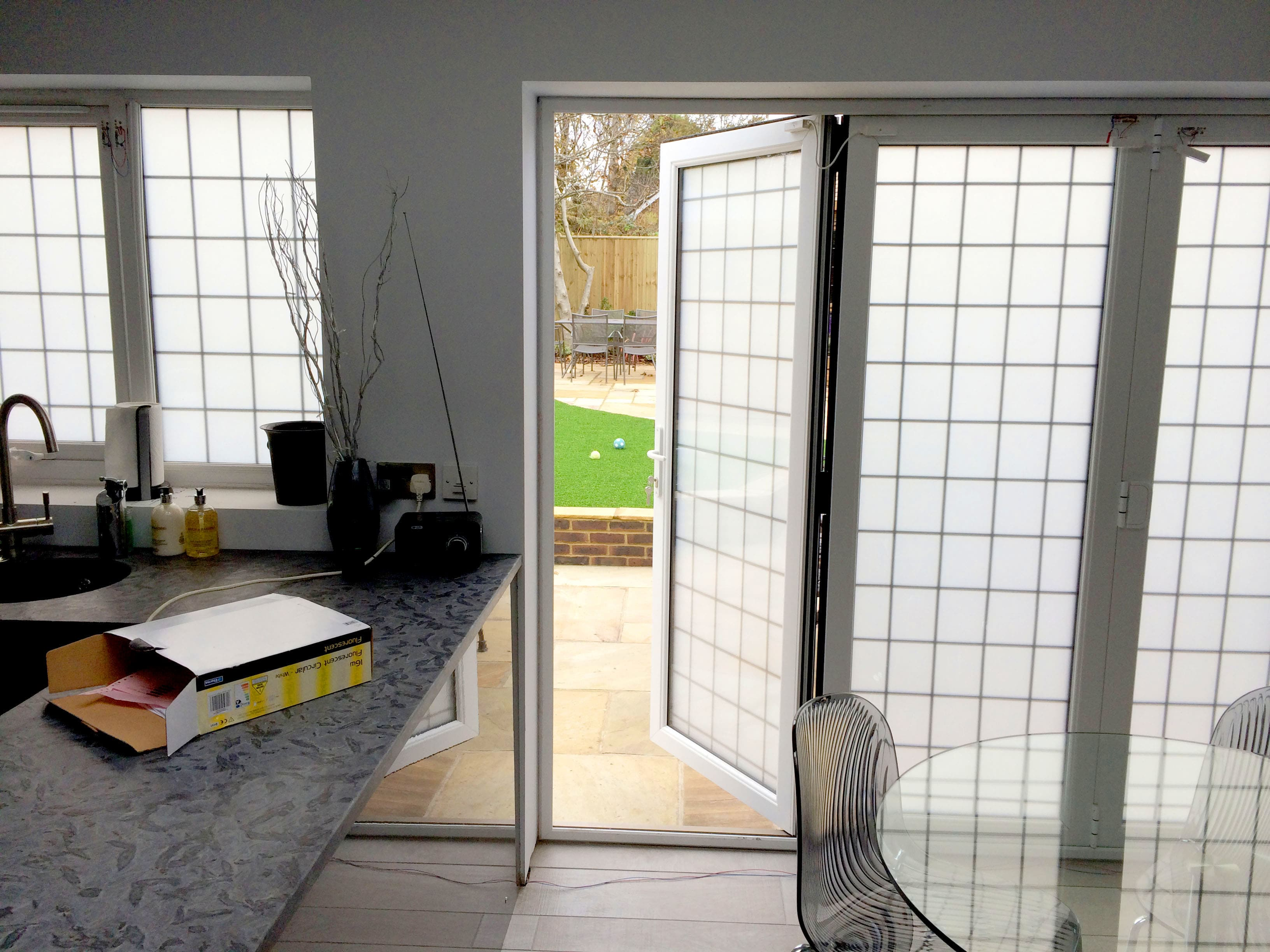 Double Glazed Smart Glass BiFold Doors in a kitchen switched to off