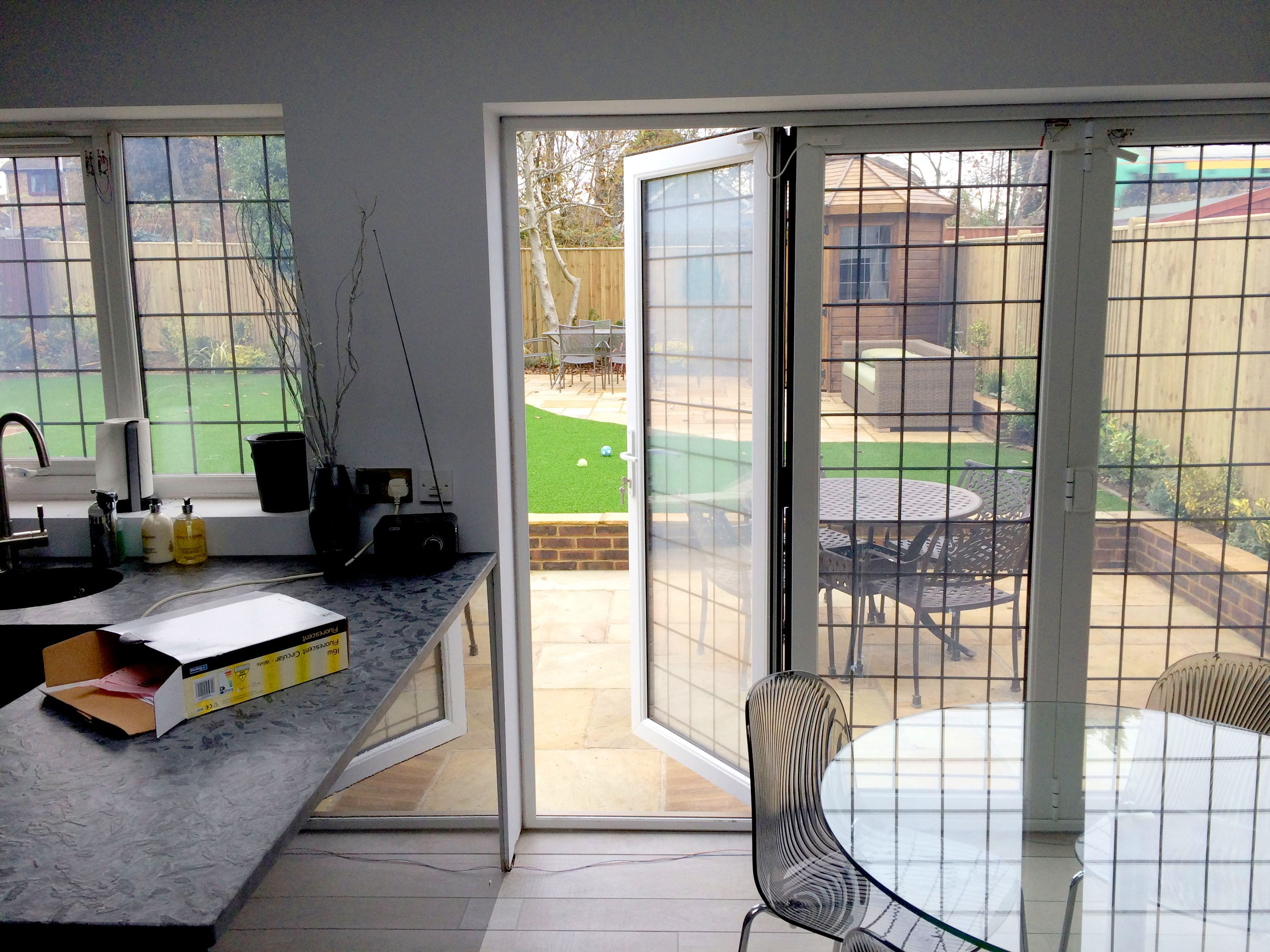 Double Glazed Smart Glass BiFold Doors in a kitchen switched to on