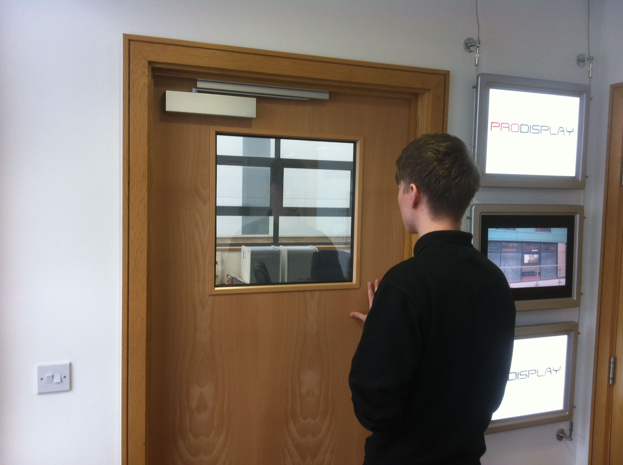 Square Switchable Smart Glass Door Vision Panel switched to on in office door