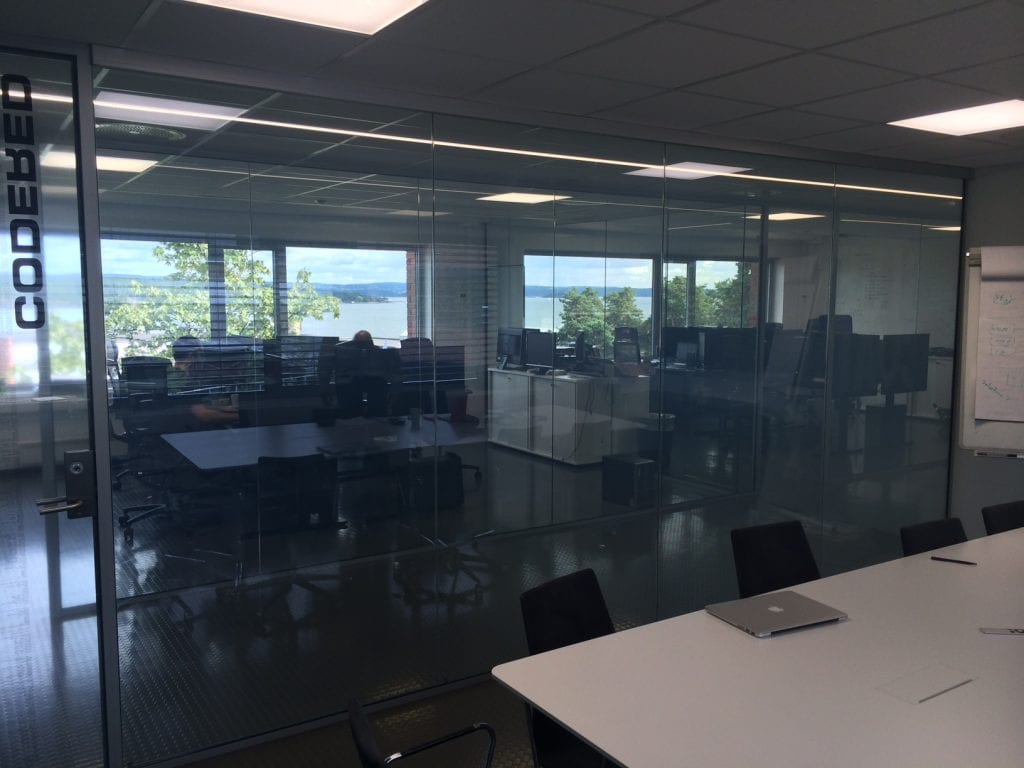 Switchable smart glass office partition - switched on clear